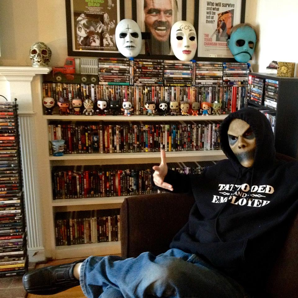 Horror Blogger Josh Millican poses with his movie collection