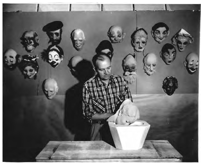 A publicity photo of Don Post Sr. pulling a blank latex mask from the mold. Masks continue to be made the same way to this very day. Photo credit: The Illustrated History of Don Post Studios by Lee Lambert. © Lee Lambert.